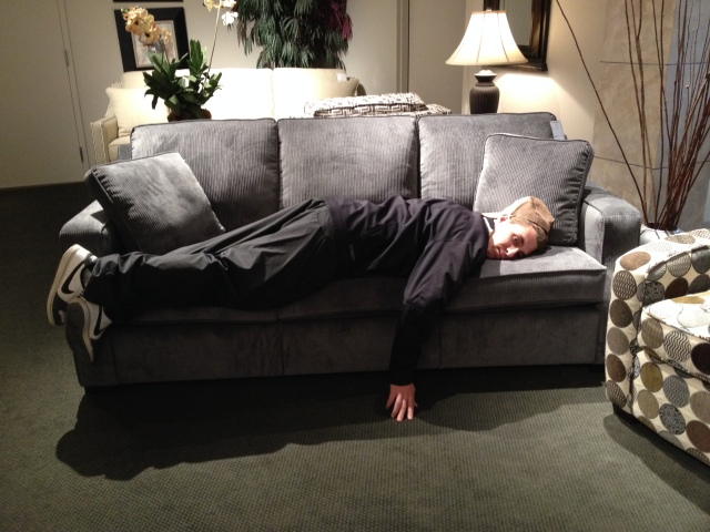 "My love having the time of his life shopping for sofas. Pulling a page from Goldilocks' fable, ""This one is too hard."" (Stefania Lamacchia photo)"