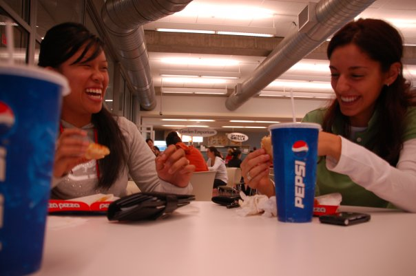 Rosalyn and Stefania take a lunch break (always Hawaiian pizza because there was no choice on campus) in J-School.